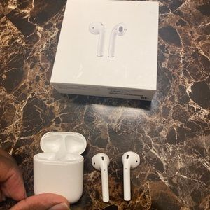 Apple Airpods 1st generation with charging case.